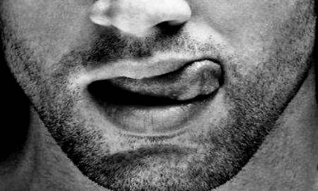 man-going-down-on-a-woman-tongue-sticking-out-black-and-white