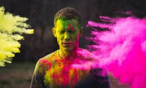 man-eyes-closed-color-pink-yellow-holi